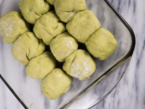 Matcha Hot cross bun dough inside 9 inch baking pan